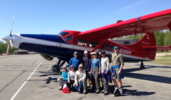 The team at the airstrip, ready to fly!