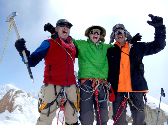 """Lloyd, Zac and Rick at the """"Edge of the World.""""  This spot is next to the big 14,200' camp, and overlooks a 4000' drop to the NE Fork of the Kahiltna Glacier.  Too bad they weren't having any fun... ;-)"""