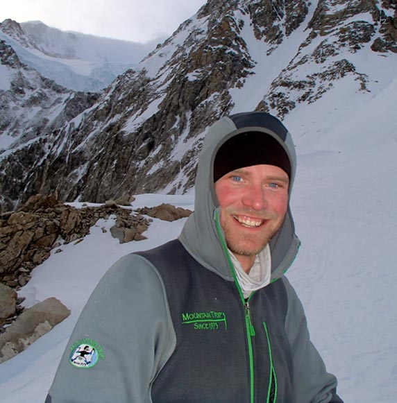Mountain Trip guide Kyle Bates product tests the Piton Hybrid Hoody at 12,000' on Denali's West Buttress.