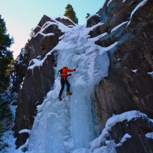 Beginner/novice ice climber going up the ice.