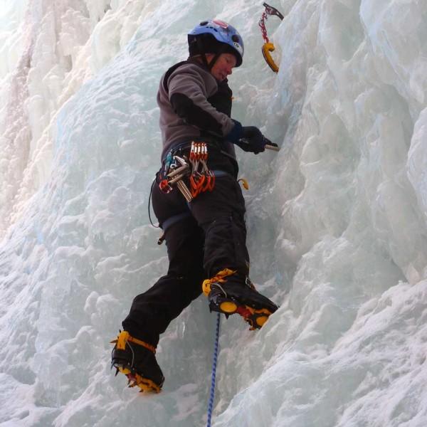 Woman ice climbing.