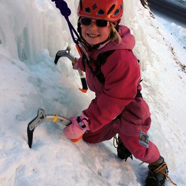 Kid ice climbing.