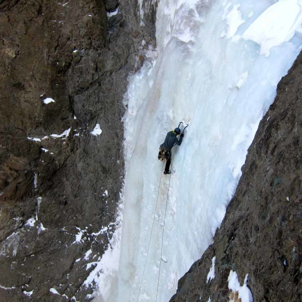 Man Ice climbing.