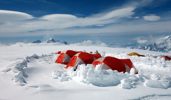 14 Camp with wind clouds. Note the snow walls constructed around the tents to fortify camp.