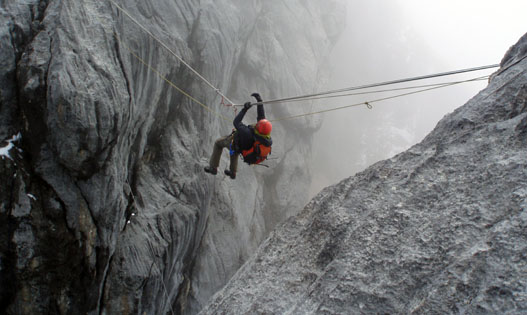 The iconic Tyrolean Traverse that spans one of the cruxes of the route up Carstensz Pyramid.