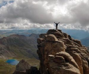 A climber atop Pilot's Knob, a 13er above Ice Lake Basin.