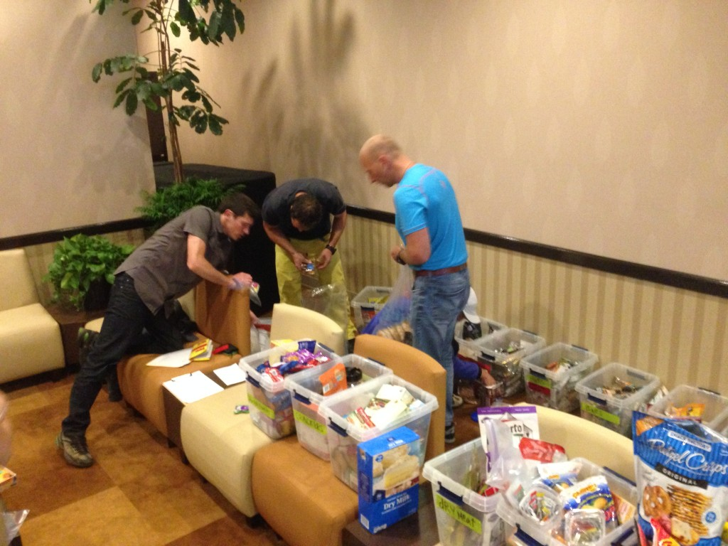 Team members packing lunch food and snacks at the Millennium Hotel.