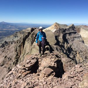 Guide Dave Ahrens on top of Dallas Peak, a centennial 14er above Telluride.