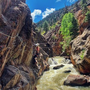 Crossing iron rungs just feet above the Uncompahgre River rushing below.