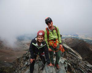 Guide Fischer Hazen and guest near the summit of Wilson Peak.