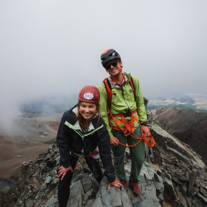 Guide Fischer Hazen and guest near the summit of Wilson Peak.