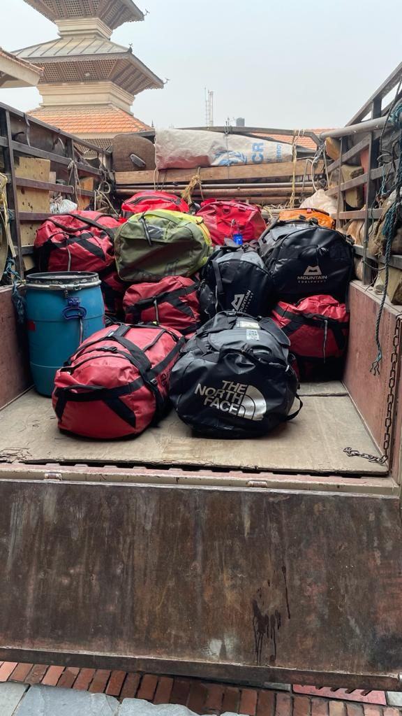 Bags for basecamp loaded into truck and heading off to the airport
